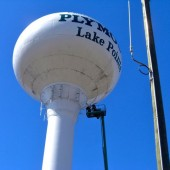 Workers used a he aerial boom to remove outdated Nextel antenna panels from the Lake Pointe water tower last week