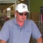 Police Surveillance Photo of Fraud Suspect