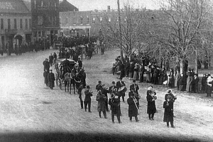 A funeral procession in Goderich, Ontario on Nov. 27, 1913-Horse drawn hearses led by a band, carrying the coffins of five unknown sailors.