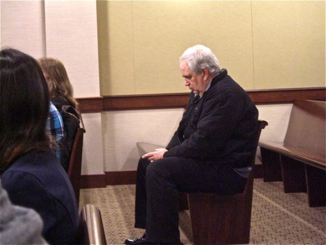Township Treasurer Ron Edwards waits in th District Court in December