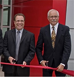 Robert Ficano and Plymouth Township Supervisor Richard Reaume at ribbon cutting for new Robert Bosch facility