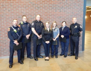 Among those receiving awards from Northville Township for their heroic efforts in saving the life of a 20-year-old woman last December were, from left, Firefighter Will Caruso, Firefighter Brent Muller, Police Ofc. Christopher Cox, Danielle Teper, Dispatcher Jennifer Allen, Dispatcher Jeanette Schrameck and Police Ofc. Douglas Scoggins.