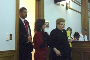 Sikorski (c) escorted into court following her attorney-35th District Court-Plymouth