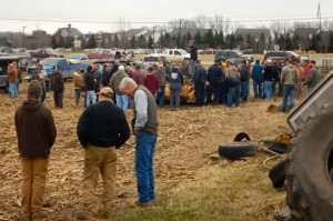Farmers from across the state get ready to bid on the equipment and farm implements during the auction last week at one of the last farms in Northville.