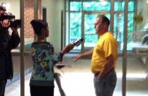 Fox-2 TV reporter Ingrid Kelley questioned Mike Mitchell in Plymouth Township Hall, July 2015