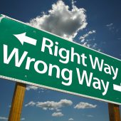 """""""Right Way, Wrong Way"""" Road Sign with dramatic blue sky and clou"""