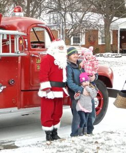 Brooklyn and Haidyn Gambrell of Thornridge Drive pose with Santa